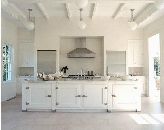 A manor-worthy kitchen in the Hamptons by Haynes-Roberts, see more at Design Sleuth: Retro Icebox Hardware.