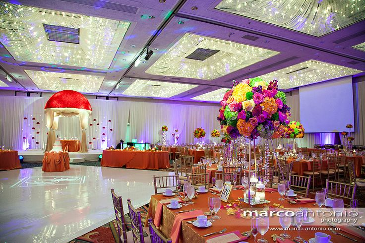 Love these bright flowers and the stunning mandap that's covered in roses!