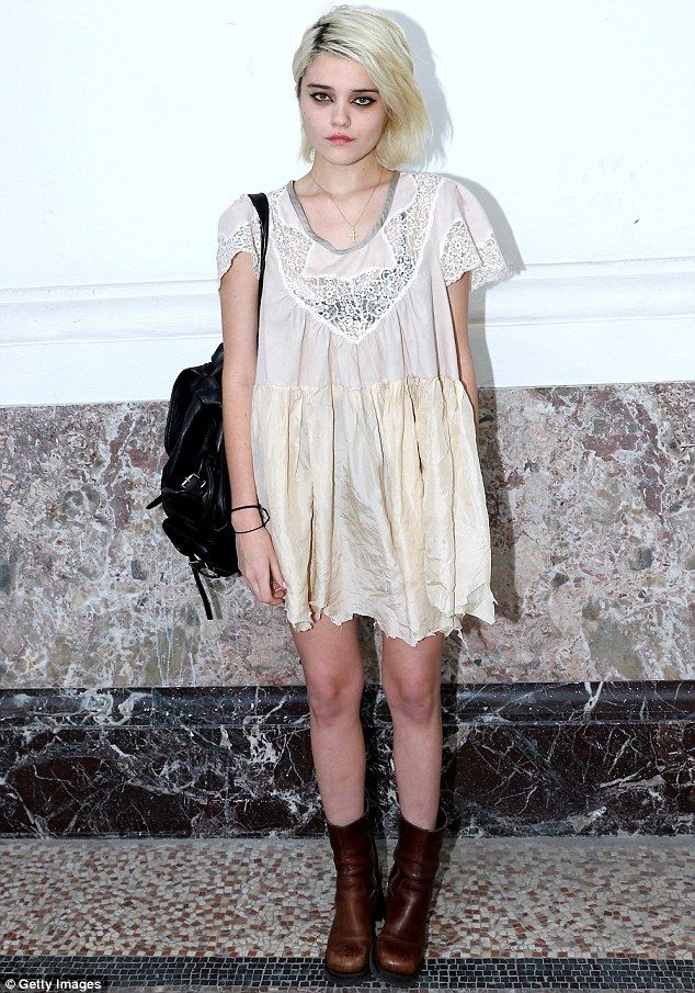 Changing up: The singer, seen at Paris Fashion Week in June, has now dyed her light hair a...