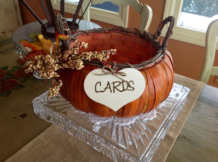 Forego the traditional cards basket and use this pumpkin wedding basket, $29.99, via Etsy.