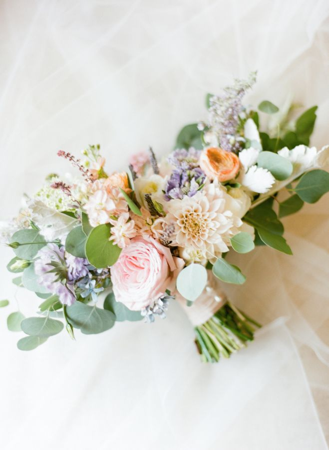 Rose, dahlia and ranunculus wedding bouquet: http://www.stylemepretty.com/virginia-weddings/north-garden-virginia/2017/03/28/both-the-bride-and-the-groom-wore-louboutins-and-were-in-love/ Photography: Rachel May - http://rachel-may.com/