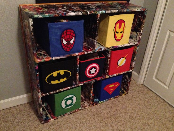Superhero fabric bins and comic book decoupaged cubbies!