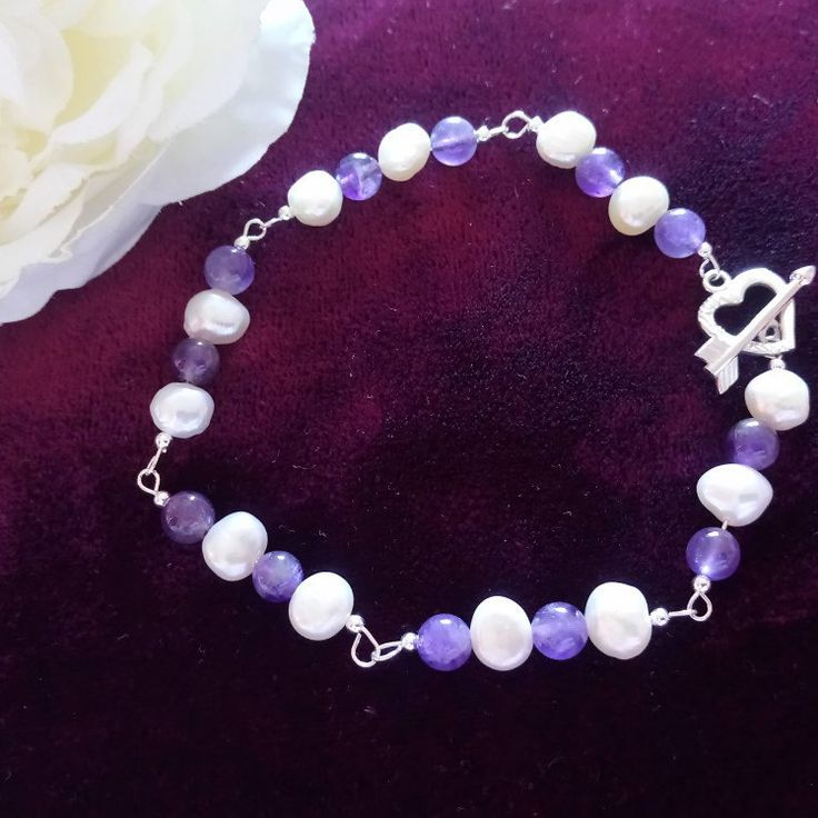 New today this effortlessly beautiful Freshwater pearl and amethyst sterling silver bracelet, comes beautifully boxed as standard the perfect gift £21.95