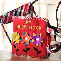 A busy book - pages inside are good ideas to keep kids entertained