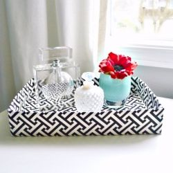 Make a decorative tray from a recycled cardboard box, a bit of fabric, and hot glue.