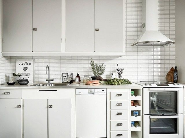 Bright white kitchen with gray cabinents