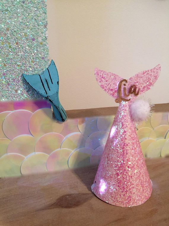 Party like a mermaid with these Mermaid party hats. Chose from 4 glitter colors or select all 4. Colors: Purple White Pink Aqua  .