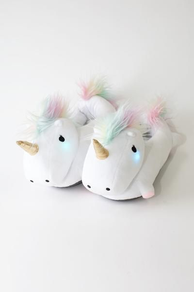 Description Features Specifications For the girl who totally knows that Cozy is Bae, our adorably plushy Unicorn Slippers will keep your feet warm and your hear