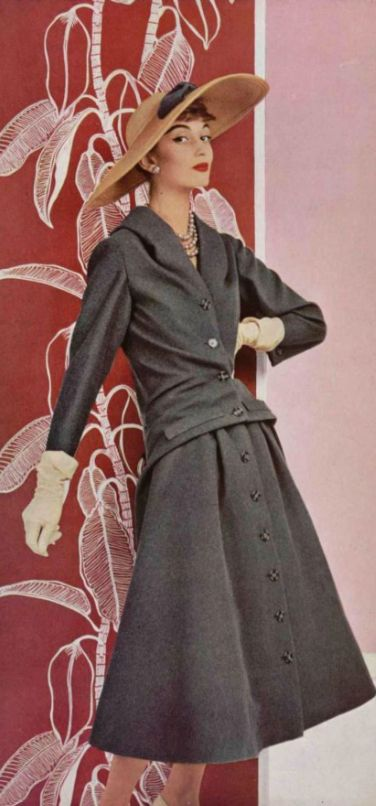 1955 Christian dior mid 50s designer couture grey suit dress coat button front wool winter hat gloves color photo print ad model magazine