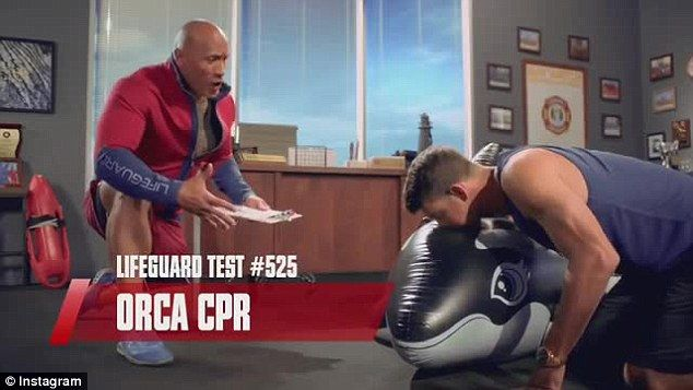 Put through his paces: Michael Phelps tries out to join the Baywatch team in a funny new ad shared by Dwayne 'The Rock' Johnson on Monday