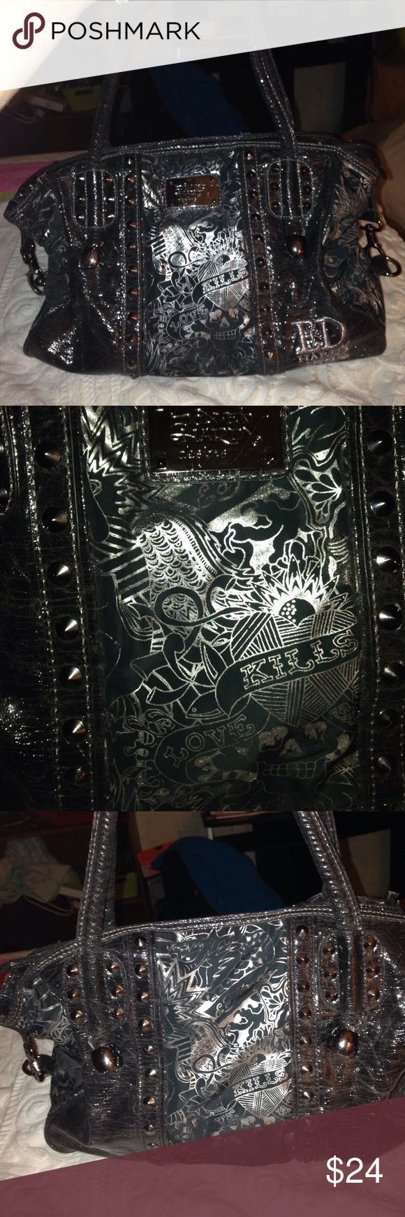 Don & Ed Hardy 7829 Melrose Handbag Satchel Black and silver large slouchy satchel/shoulder bag is in good, preowned condition.  Love Kills motif.  Three pockets inside and has Signature lining.  Cone studs decoration. Ed Hardy Bags Satchels