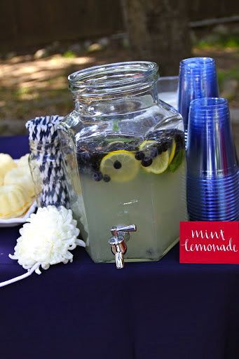 Blueberry lemonade with blue and white straws! | nautical themed baby shower @Cyndi Price Price Price Madsen water or lemonaide with lemons/blueberrys!  also easy and super cute!