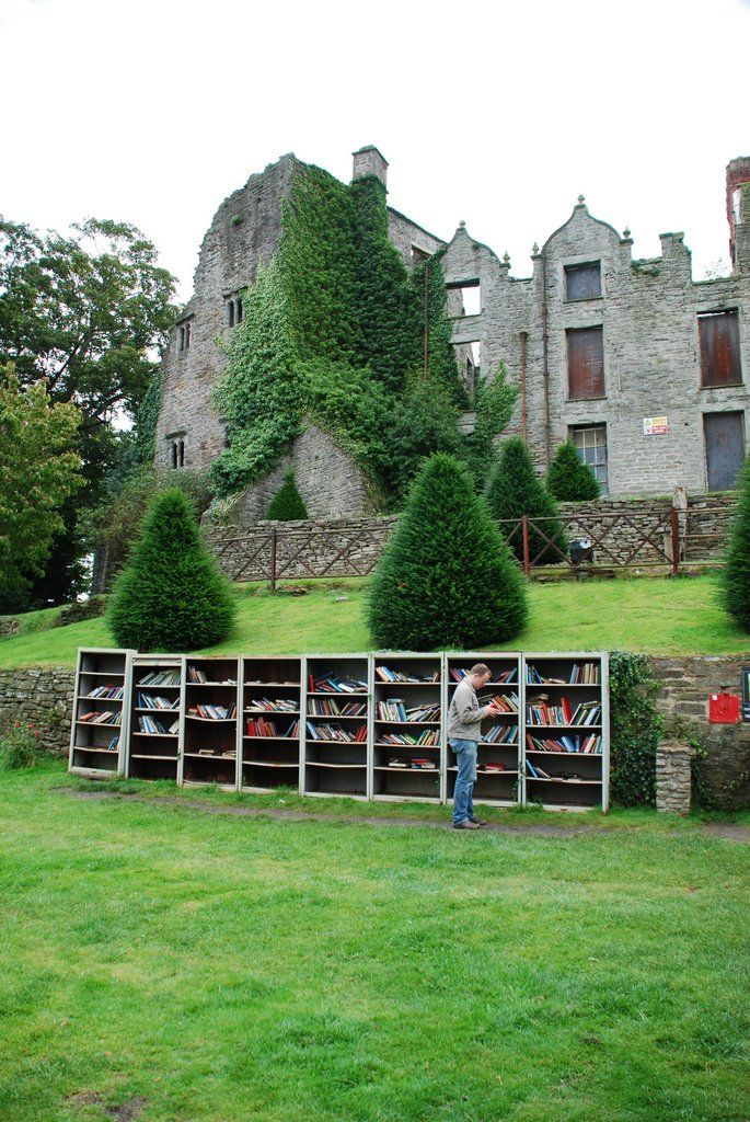 Hay-on-Wye, Wales -- a town filled with bookstores. Note the bookshelves outside Hay Castle.