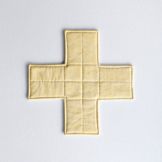 Yellow, quilted, cross-shaped trivet or potholder, tableware by EdgeEffects