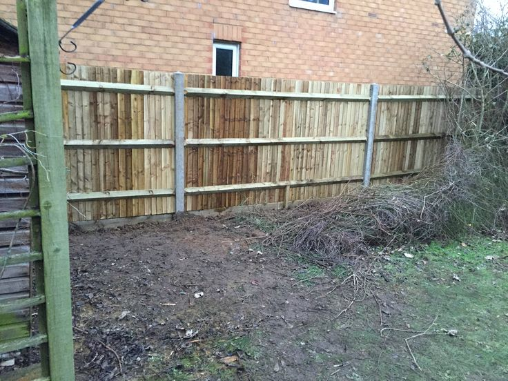 close board fence with concrete morticed posts, arris rails and wooden gravel boards.