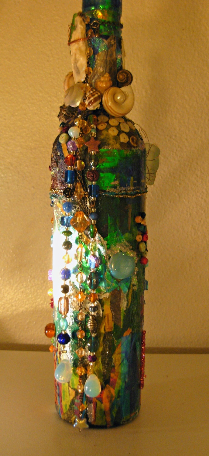 Beads and the Sea Art bottle made from various beautiful natural items.. via Etsy.