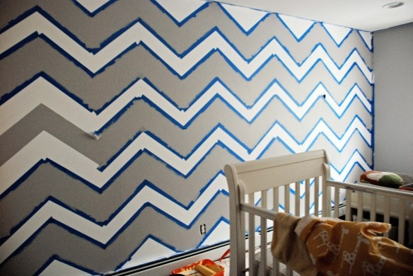 Chevron Stripes on the wall-- this looks like a big, fat pain of a project, but the effect is oh so awesome!