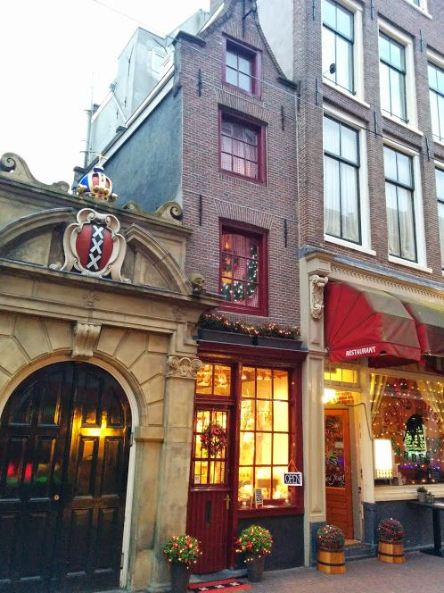 "The Smallest House in Amsterdam is located at Oude Hoogstraat 22 in the old city center. 2.02 meters (6-ft 8"") wide & 5 meters (16-ft 5"" deep."