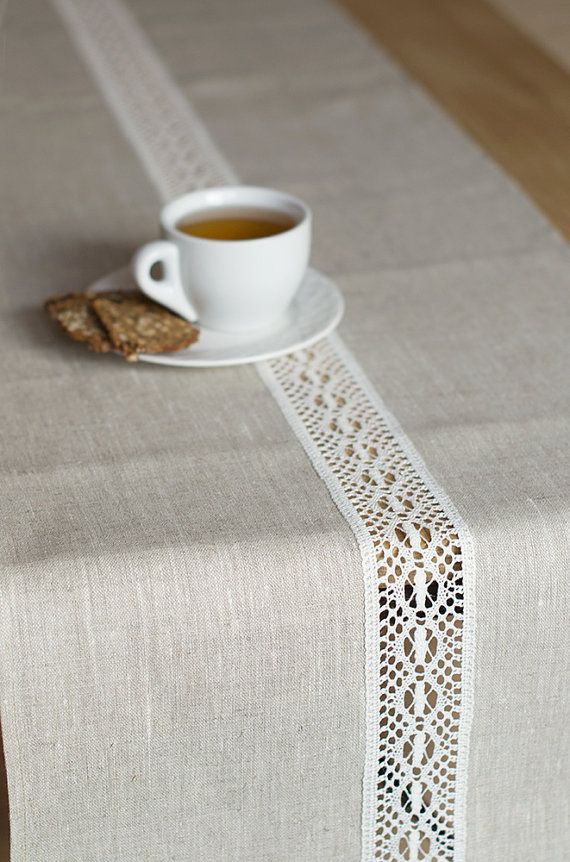 Linen runner made from tan / ecru linen with white lace on the center. This linen runner beautiful Easter, weddings and other special occasions.  In most homes, besides having the meals, dining is also a time when the entire family takes out time to sit together and discuss the happenings of the day. We all love to dress our tables as much as we love to eat great food as it just multiples the aesthetics and comfort zone that we create for ourselves.  A modern twist of rustic and elegant…