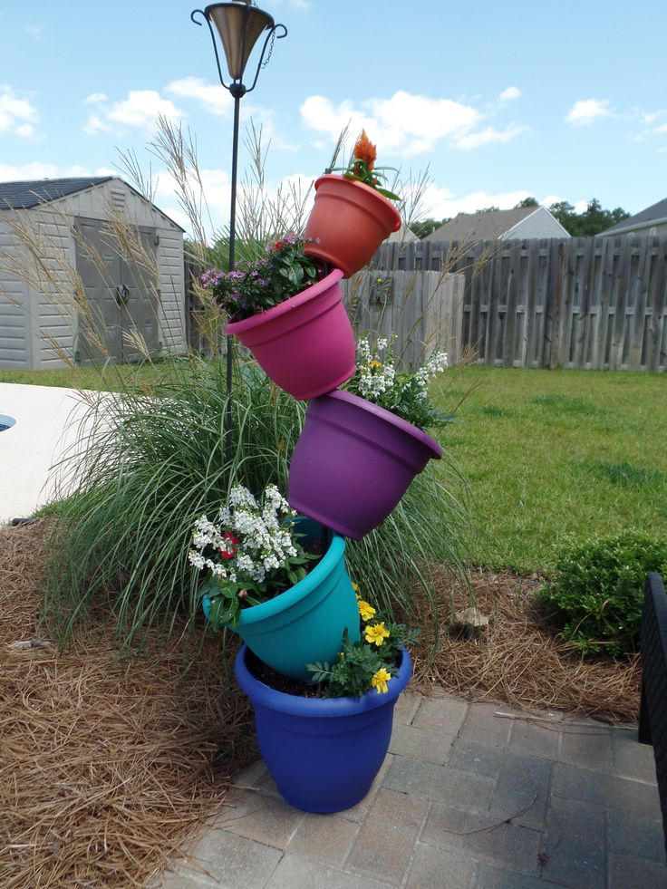 Colorful topsy turvy flower planter - tipsy pots