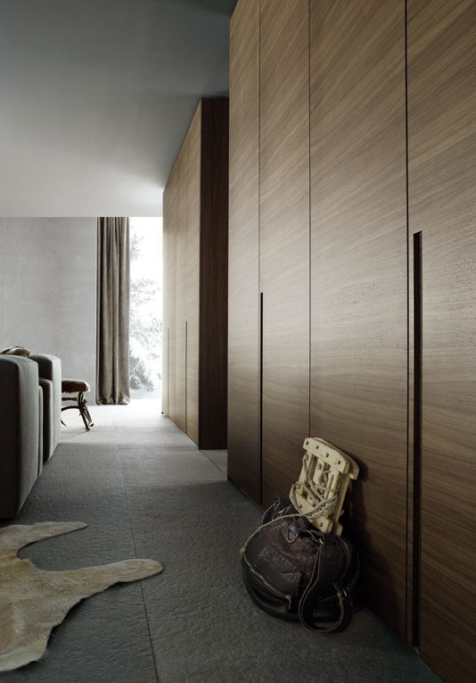 I love these wardrobe doors and the organic feeling of materials. Poliform - Madison wardrobe