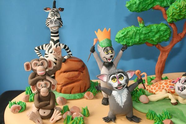 This marvelous Madagascar Cake features Alex, Marty, Gloria, Melman, King Julien XIII, Maurice, Skipper, Kowalski, Private, Rico, Mason, and Phil.