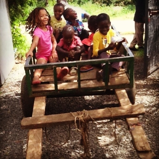 An afternoon ride on the water cart at the Suluhisho Children's village in Kenya. Lots of smiles and laughter. Check us out at www.suluhisho.com