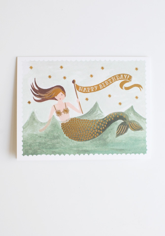 "Vintage Mermaid Birthday Card By Rifle Paper Co. 4.99 at shopruche.com. Beautifully gilded with gold foil for a sparkling way to say, ""Happy Birthday!"" This charming card by Rifle Paper Co. features a vintage-inspired mermaid print and a blank interior. Envelope included.5.5"" x 4.25"", Printed..."