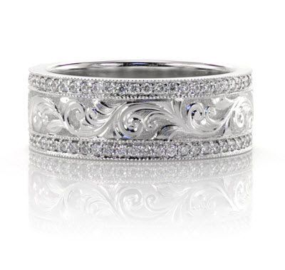 Hand Engraved Wedding Ring in platinum with bead-set diamonds.