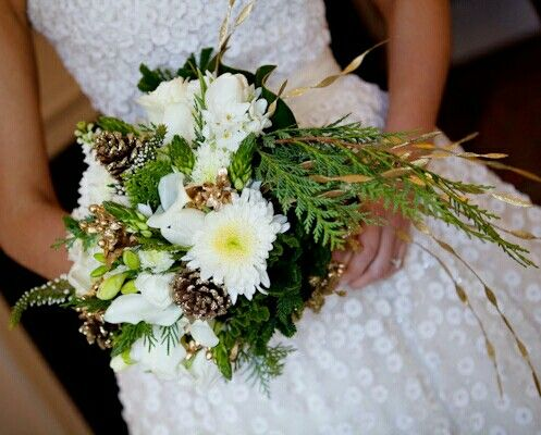 Winter/Holiday Bridal Bouquet Featuring: White Chrysanthemums, White Tulips, Paperwhites, White Freesia, White Mini Calla Lilies, White Veronica, Star Of Bethlehem + Buds, Gold Pine Cones, Evergreen, Greenery/Foliage ••••