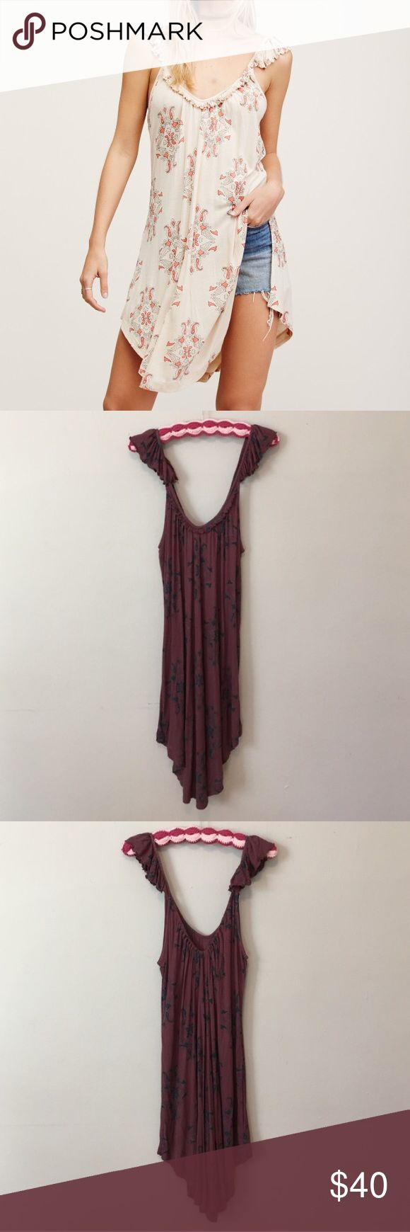Free People Drifter Tank Tunic Purple Sz XS NWT Hey Honey! This sale is for a Free People Drifter Tank Tunic Purple Sz XS NWT. First picture is just for fit, this Tunic is actually a purple/pink color. Please ask any questions you have because all sales are final. 🚫Trades😊 Free People Tops Tunics