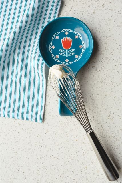 Keep your countertops clean and bring the fresh and oh so cute Now Designs Tulipa Spoon Rest to your kitchen. Featuring a rich turquoise blue colour and featuring a Scandinavian inspired mid century modern print with a bright coral red tulip, the Now Designs Tulipa Spoon Rest will look great in any home. Accommodating large soup ladles and balloon whisks, to small mixing spoons and spatulas, the Now Designs Spoon Rest has everything you need to start spring off on the right foot!