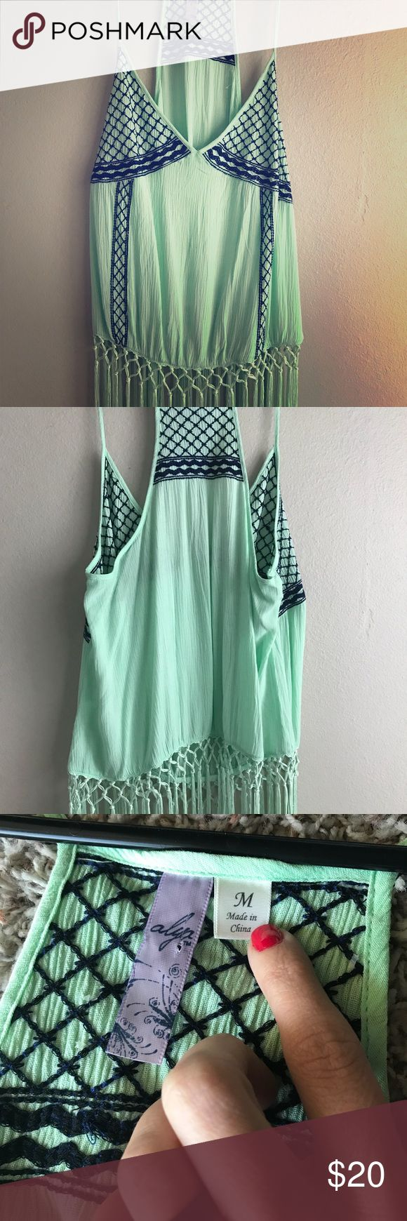 Mint green fringe cami top This top is 100% rayon with royal blue embroidery and mint green fringe. It is a perfect summer cami! Tops Camisoles