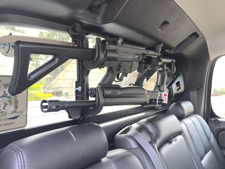 2007 Chevy Avalanche gun storage mod hatsan escort shot gun and GSG522 mounted on the back glass of truck.