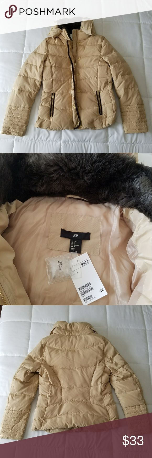H&M down feather filled puff jacket. With faux fur Get ready for the winter with this down feathered filled jacket. The neckline is lined with faux fur for extra warmth and comfort. The back of the neck line has a hidden zipper compartment which reveals a hood when opened. It also has two pockets in the front to store your favorite lip gloss or moisturizer. Buttons are slightly worn but work as well as all zippers. Has slight markings on the back and left arm, very unnoticeable from far…