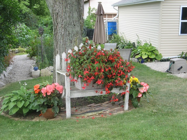 Flowers on bench walkway with rock gardening ideas for Flower bench ideas