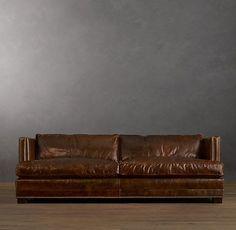 Sofá de couro marrom escuro