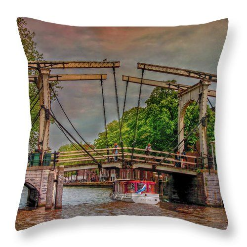 Most Amsterdam houseboats are like small houses, built on the water. They have a terrace and a small garden on the deck. Today all houseboats are permanently connected to the public sewer and electricity network of the city. - Pillow by Hanny Heim, Snowbird Photography #photography   #holland   #netherlands   #houseboat   #cities   #amsterdam