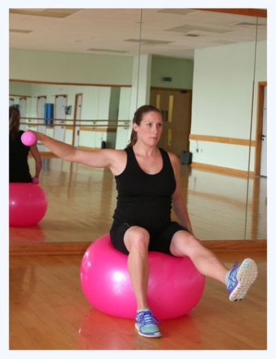 Pregnancy exercise ball workouts for a fit pregnancy! This arm and leg workout also works shoulders and core too, for all-round pregnancy fitness! Click to see how