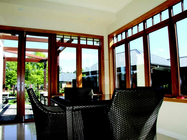 Full length glazing in the sunroom creates a light and airy living space.
