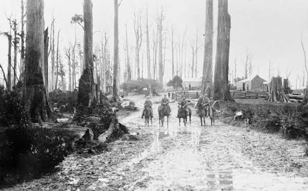 1913 Grand Ridge Road at Gunyah  the Country Roads Board members leaving Rogers Hotel. VicRoads Centenary 1913-2013.
