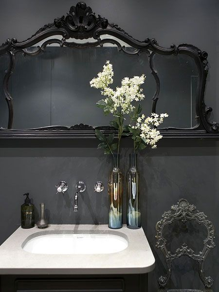 Go for drama in your bathroom by painting it all black. Finish the look with an ornate mirror and chair for total relaxation. (Photo: Jake Curtis)