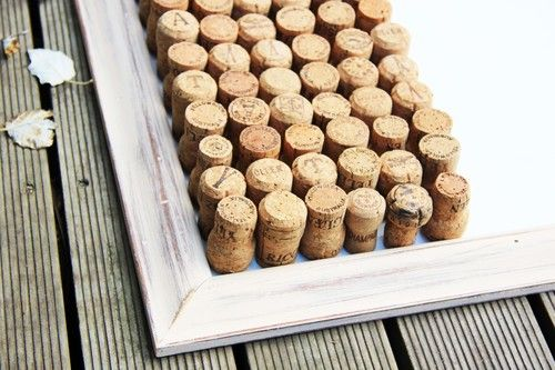 """This decorative piece can bring a rustic, traditional, mature, and homely feel to any room, and will definitely be a winner with the visitors. With over 70 wine/Olive Oil corks intricately secured onto a hand-painted cream frame, this personalized item can offer the right ambience for you. Place it in your kitchen for reminder notes or in an office and keep everything exactly as organized as you like it. 23"""" X 29"""""""
