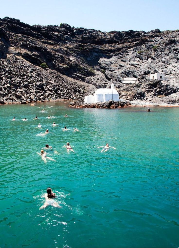 Swimming in the volcano hot springs. Santorini island, Greece - Selected by www.oiamansion.com