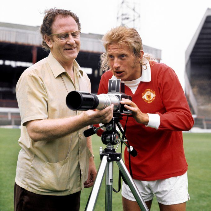 Denis Law takes a peek through the camera before Manchester United's league tie against Crystal Palace, 1972