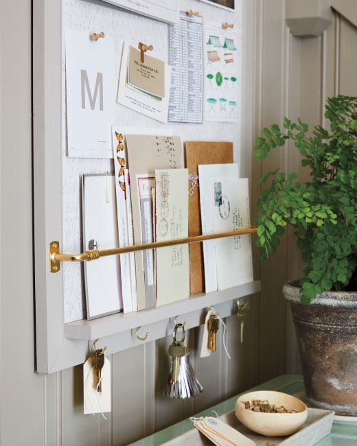 So smart! Add a narrow towel bar and 1 x 1 trim to a bulletin board to hold mail, paper etc..