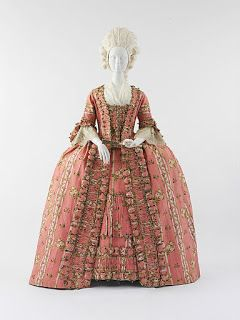 Compére Front Dress, ca. 1775, Metropolitan Museum of Art. A compère front is a stomacher which buttons down the front; some compère fronts also used hook and eye as closure. The compère stomacher can be sewn to the dress or pinned like an original stomacher, in which case the buttons might only be there for decorative purposes and serve no actual function.