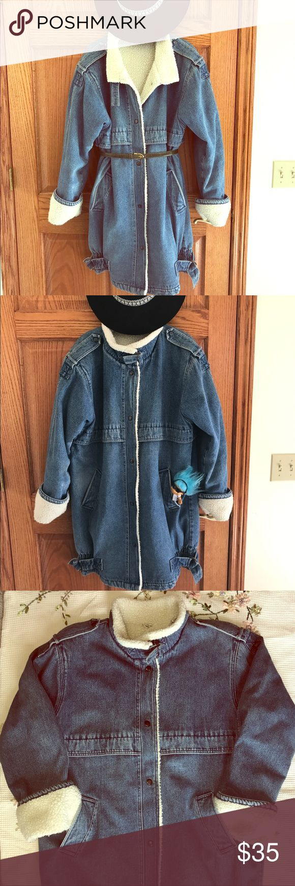 VINTAGE🔥 Stylish Wool-lined Denim Coat! 💕 Awesome vintage denim coat size large with wool-type fuzzy lining throughout, front pockets, snap button closure, and buckle accents at neck and bottom sides! Has button snaps at shoulders and slight shoulder pads inside as well. So versatile and fun!! In excellent vintage condition with some mild fading and only a small scratch on very top button as shown in last photo! Approx. measurements laying flat: chest- 24.5in, shoulders- 21in, length…