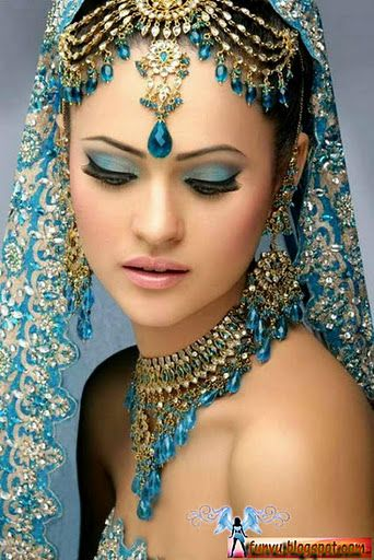 www.weddingstoryz.com maybe i could do a veil like this with a similar style headdress with silver and pearls instead of gold and blue crystals. weddings indian desi bride candid photography www.amouraffairs.in