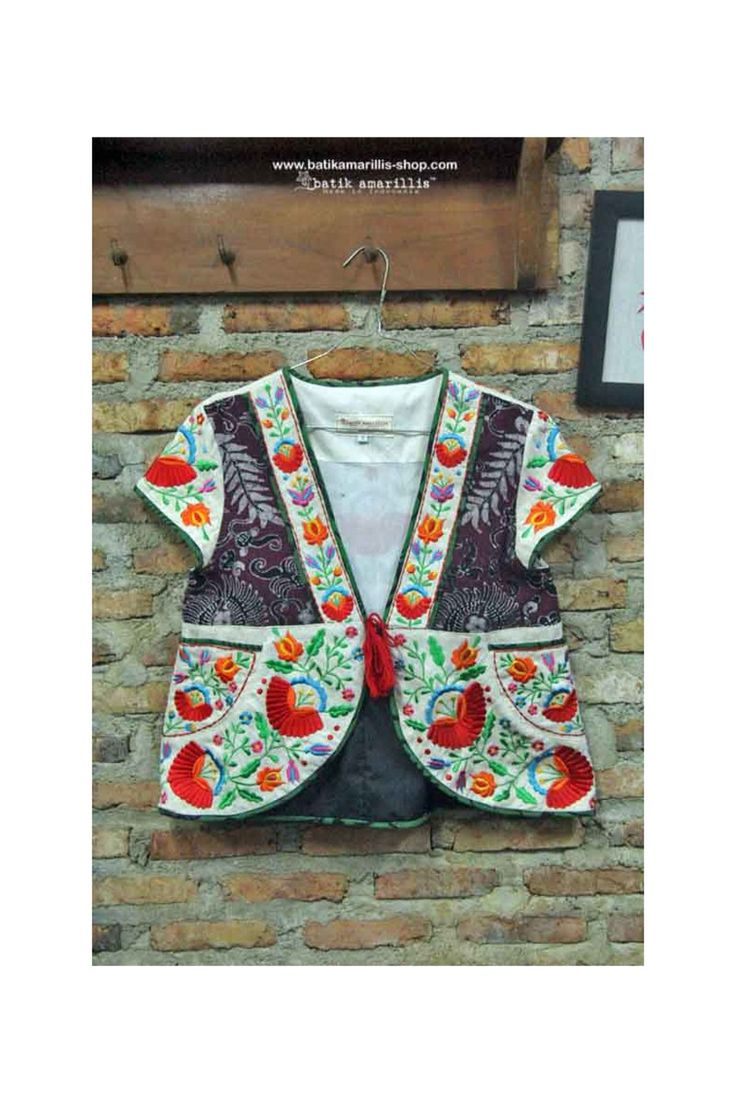 batik amarillis's garden vest This is when Indonesia's traditional textile :Tenun Gedog Tuban meets Hungarian embroidery This beautiful craftmanship features hand